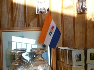 Old apartheid-era flag for sale at the Blood River Heritage Site and Museum - 2012